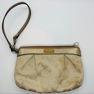 Coach gold/cream convertible wristlet/purse